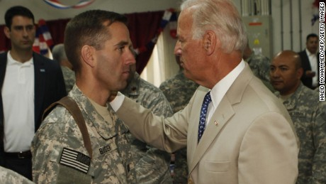 Caption:U.S. Vice President Joe Biden (R) talks with his son, U.S. Army Capt. Beau Biden (L) at Camp Victory on the outskirts of Baghdad on July 4, 2009. Biden said that America's role in Iraq was switching from deep military engagement to one of diplomatic support, ahead of a complete withdrawal from the country in 2011. AFP Photo/ Khalid Mohammed-POOL (Photo credit should read KHALID MOHAMMED/AFP/Getty Images)