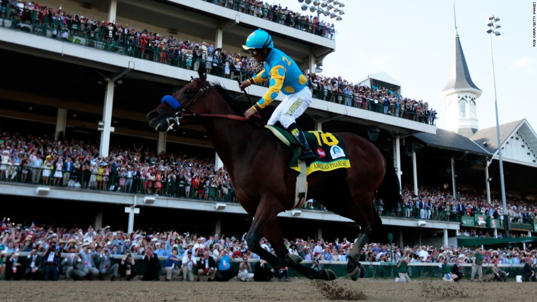 MAY 2 2015: The start of an amazing year for American Pharoah and his team. Jockey Victor Espinoza, celebrates his second successive Kentucky Derby after being victorious on board California Chrome 12 months earlier.