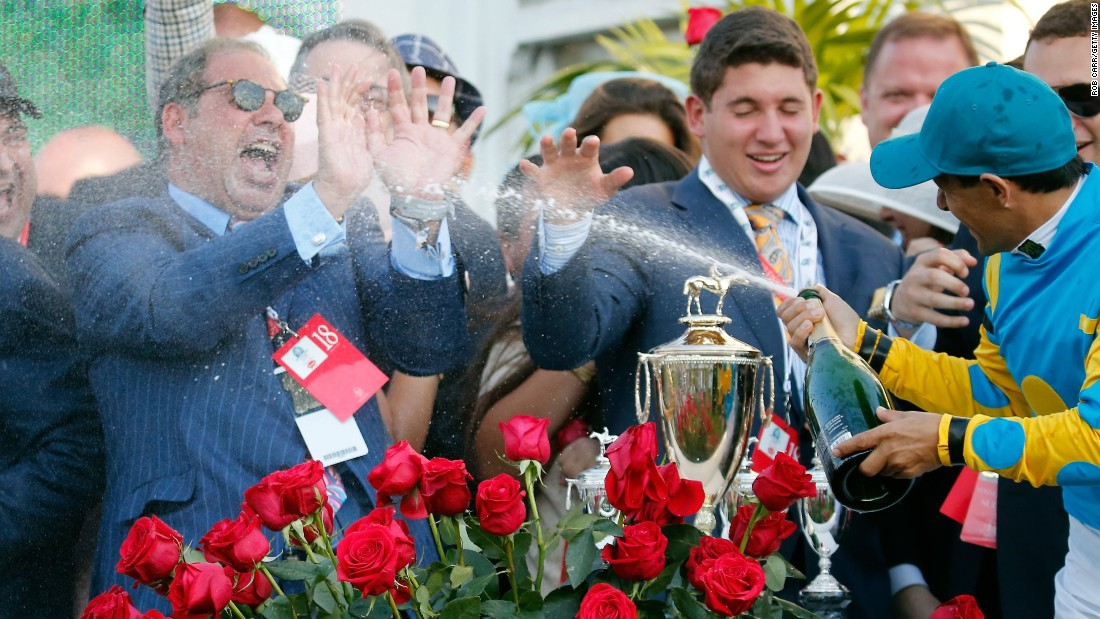 American Pharoah's owner, Ahmed Zayat, is sprayed with champagne in the Derby celebrations. Zayat made his money predominantly from selling his Egyptian brewing business to Heineken for an estimated $280 million.