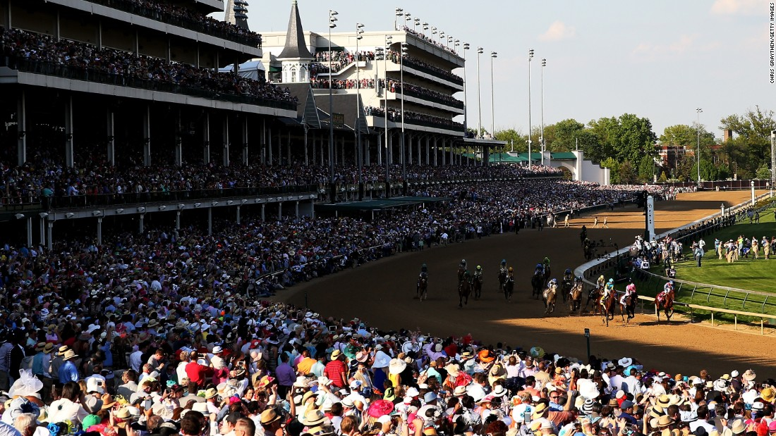 The crowd watches American Pharoah win the Derby and its $1.2 million prize.