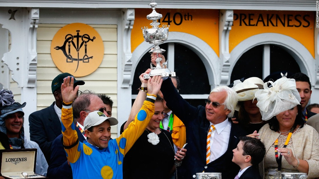 Espinoza and trainer Bob Baffert celebrate in the Preakness winner's circle.