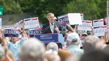 Surrounded by supporters waving signs and flags, U.S. Sen. Lindsey Graham (R-SC) announces his candidacy for United States President during an outdoor event on June 1, 2015 in Central, South Carolina. Graham is the ninth Republican to join the race for president in 2016.