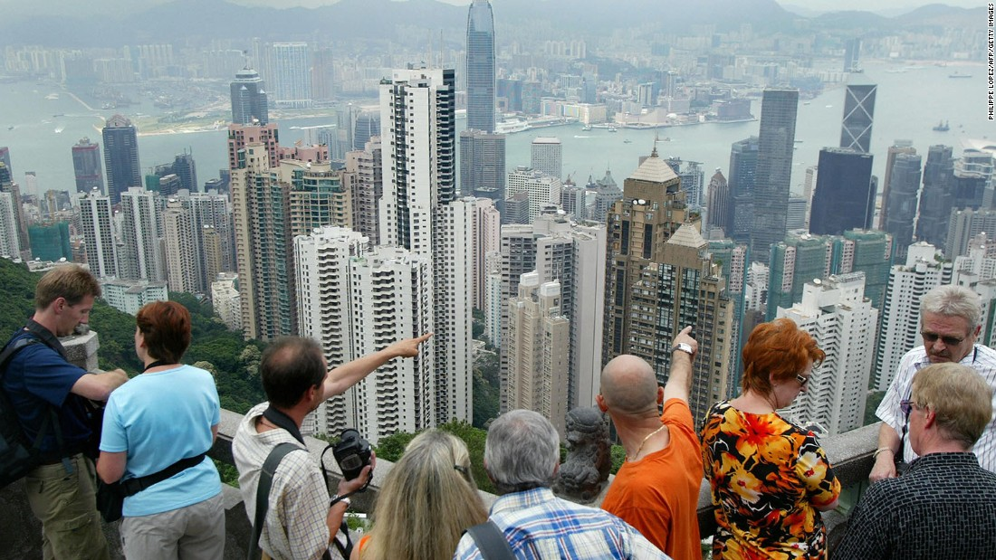 Futuristic skyscrapers next to traditional Chinese temples. It's expected that 8.66 million international visitors will come to Hong Kong in 2015, according to MasterCard's latest Global Destination Cities Index.