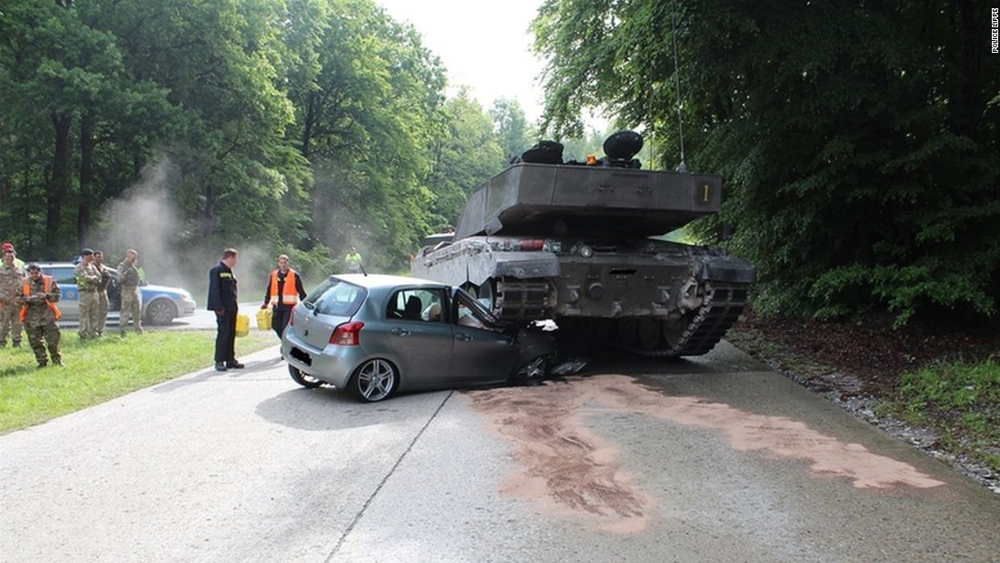A teenage driver collides with a military vehicle in Berlin, Germany on June 1, 2015.