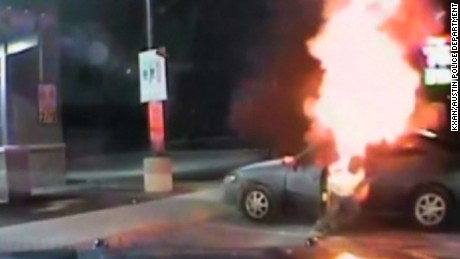 An Austin Police Department dashcam video shows a driver get back inside his car after it exploded and caught on fire.