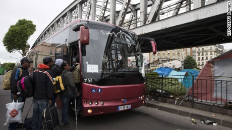 African migrants board a bus after being evicted by French police from a camp under a subway bridge in northern Paris on June 2, 2015. More than 350 refugees, most of them from Sudan, but also from Eritrea, Somalia and Egypt, have been living in the makeshift camp below the metro tracks between the stations of La Chapelle and Barbes-Rochechouart in the north of the French capital. AFP PHOTO / JOEL SAGETJOEL SAGET/AFP/Getty Images