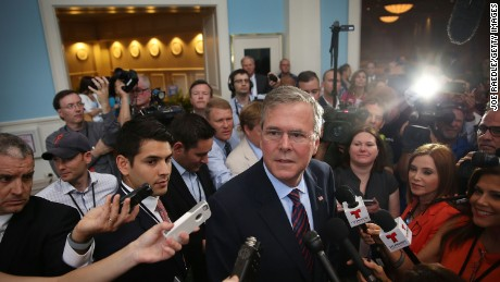 Former Florida Governor Jeb Bush and possible Republican presidential candidate speaks to the media after addressing the Rick Scott's Economic Growth Summit held at the Disney's Yacht and Beach Club Convention Center on June 2, 2015 in Orlando, Florida. Many of the leading Republican presidential candidates are scheduled to speak during the event.