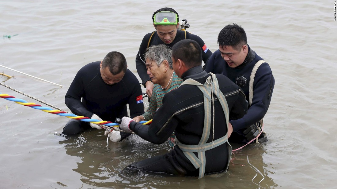 "A woman is helped by divers after she was pulled from a sunken ship in Jianli, China, on Tuesday, June 2. The Eastern Star riverboat <a href=""http://www.cnn.com/2015/06/02/china/gallery/china-yangtze-ship/index.html"" target=""_blank"">capsized in stormy weather</a> with more than 450 people on board. Days later, many of them were still missing."