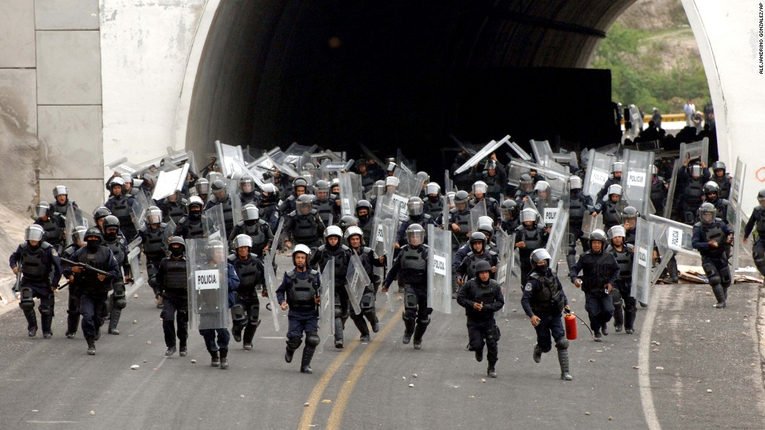"Police in riot gear chase after students of the Rural Normal School of Ayotzinapa after the students tried to reach the city of Chilpancingo, Mexico, to protest on Wednesday, June 3. In September, <a href=""http://www.cnn.com/2014/11/21/americas/gallery/mexico-missing-student-protests/index.html"" target=""_blank"">43 students from the school went missing</a> in the Mexican state of Guerrero. Four months later, Mexican Attorney General Jesus Murillo Karam said there is ""legal certainty"" that the students ""were abducted, killed, burned and thrown into the San Juan River, in that order."""