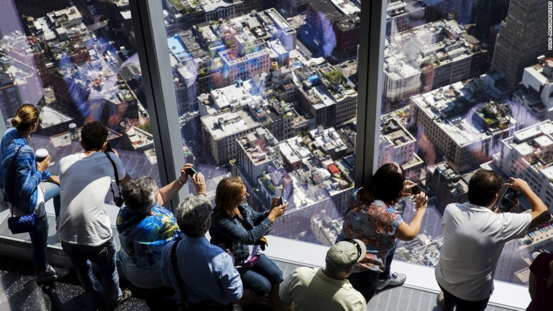 Visitors take photos from the One World Trade Center observatory, which opened to the public Friday, May 29, in New York.