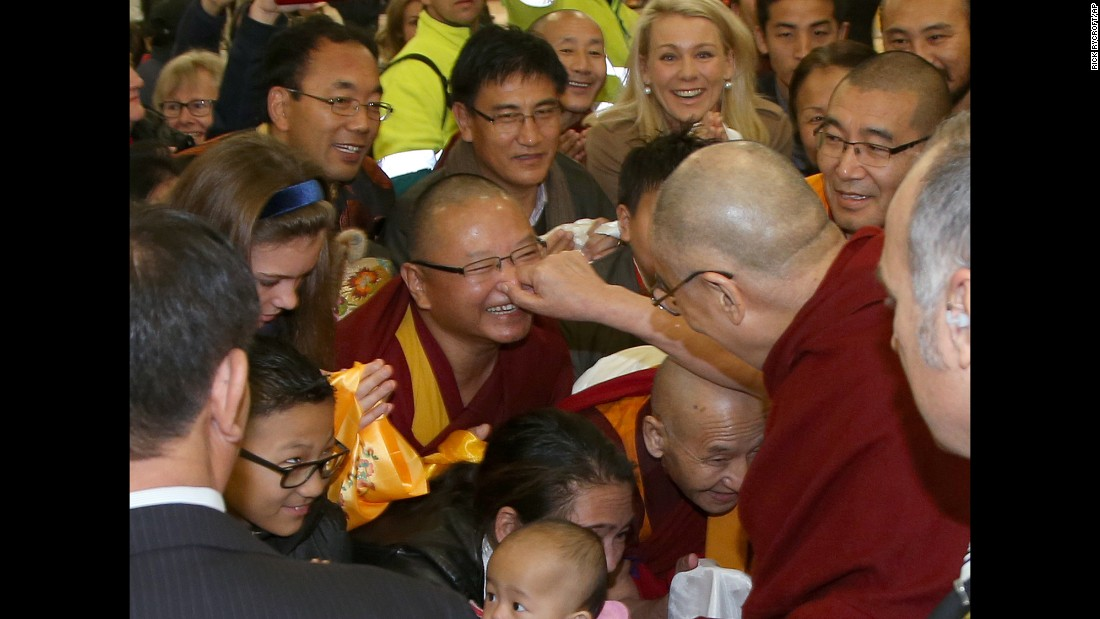 The Dalai Lama pinches the nose of a well-wisher after arriving in Sydney on Thursday, June 4. The Tibetan spiritual leader was visiting Australia for the 10th time.