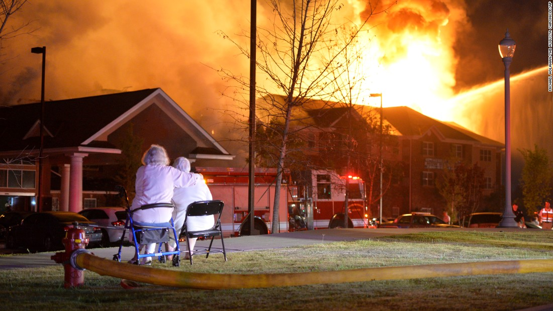 "Residents of the Marshall Square Retirement Resort watch it go up in flames Tuesday, June 2, in Evans, Georgia. One person was killed in the fire, <a href=""http://newstimes.augusta.com/latest-news/2015-06-02/fire-destroys-marshall-square-retirement-community-in-evans"" target=""_blank"">according to the Columbia County News-Times.</a>"