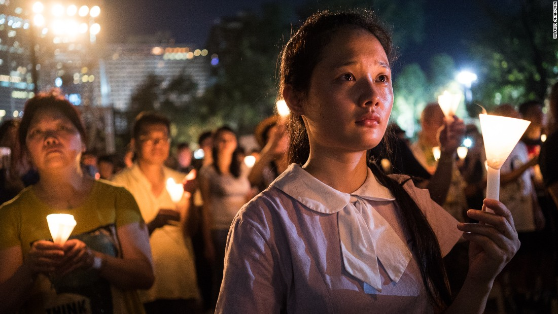 "A student raises a candle at a vigil in Hong Kong on Thursday, June 4, 2015. Tens of thousands of people attended the service in remembrance of <a href=""http://www.cnn.com/2014/06/01/asia/gallery/tiananmen-crackdown-timeline/index.html"" target=""_blank"">the 1989 Tiananmen Square protests.</a> The vigil is held annually at Victoria Park, but this year's gathering took on greater meaning after <a href=""http://www.cnn.com/2014/09/22/asia/gallery/hong-kong-students-protest/index.html"" target=""_blank"">last year's pro-democracy protests.</a>"