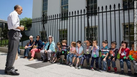 Obama stops to talk with visiting school children outside the West Wing of the White House, April 29, 2015. The President was returning from a walk with Shanna Peeples, the 2015 National Teacher of the Year, when he met the children and their chaperones.