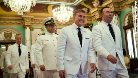 United States Ambassador to the Dominican Republic and gay rights activist James Brewster, center, arrives to present his credentials to Dominican President Danilo Medina on December 9, 2013, during a ceremony at the National Palace in Santo Domingo.