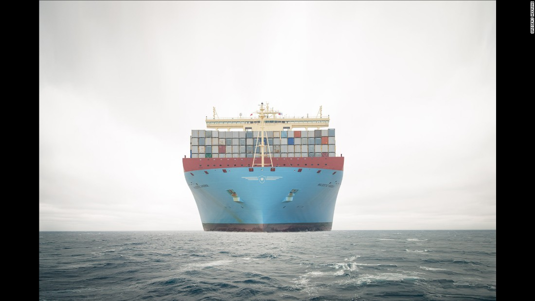 "The massive Maersk Majestic travels in the South China Sea in February 2014. The Majestic and its sister ships are taller than a 20-story building, and they are too wide to pass through the Panama Canal. ""When you really see it, it's just insane,"" said photographer Gregers Heering, who spent 32 days aboard the Majestic last year."