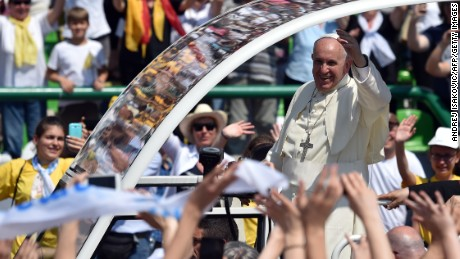 Pope Francis gives his blessing from his popemobile as he arrives to celebrate Mass at Sarajevo's city stadium Saturday. on June 6, 2015. Pope Francis arrived in Sarajevo for a visit aimed at bolstering reconciliation between war-scarred Bosnia's Serb, Croat and Muslim communities. The trip comes 20 years after the end of a 1992-95 conflict that ripped the Balkan state apart and left it permanently divided along ethnic lines. AFP PHOTO / ANDREJ ISAKOVIC (Photo credit should read ANDREJ ISAKOVIC/AFP/Getty Images)