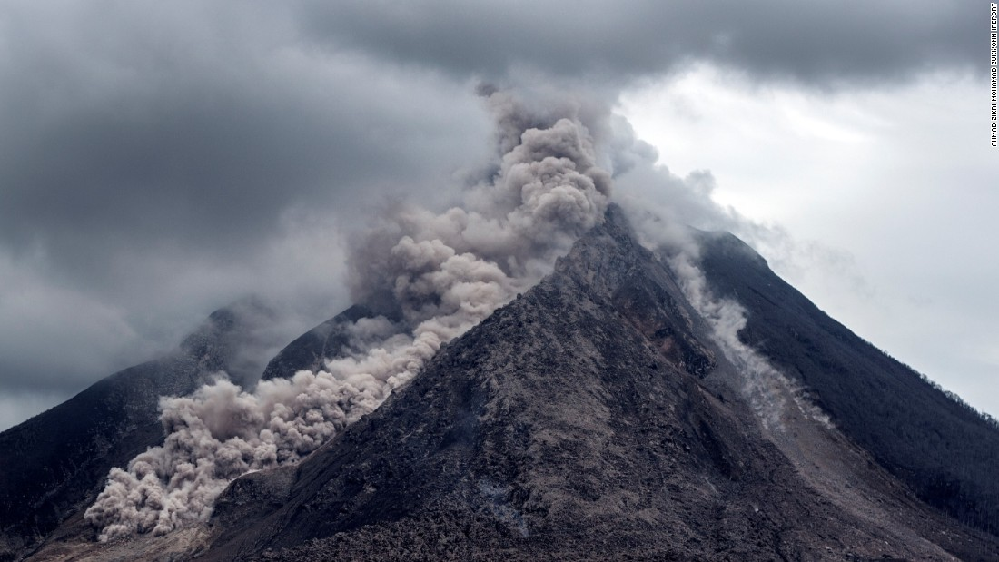 "Thick ash, rock fragments and volcanic gases pour from <a href=""http://ireport.cnn.com/docs/DOC-1246978"">Mount Sinabung</a> in Indonesia. The government's natural disaster management agency raised the alert level on Friday, June 5."