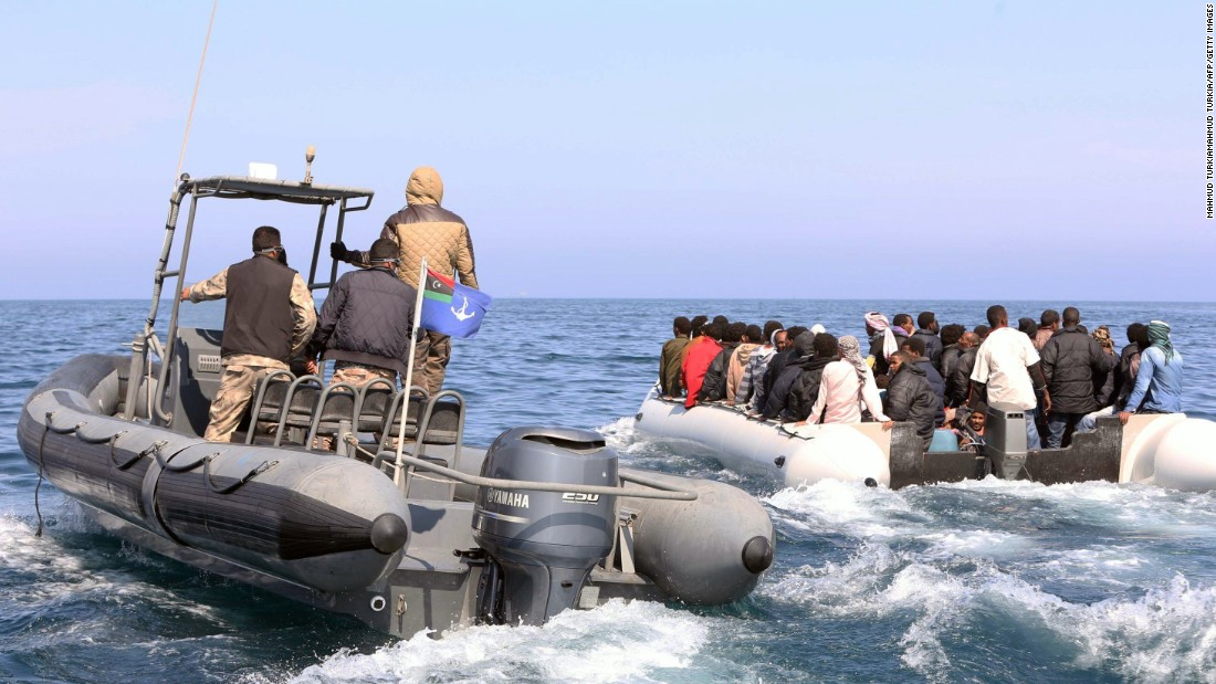 Libyan coast guard members escort a boat carrying migrants, who had hoped to set off to Europe with the help of smugglers, from the coastal town of Garabulli, Libya, on June 6.
