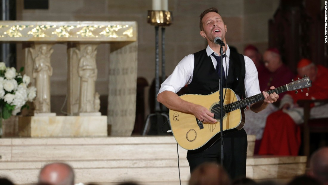 "Chris Martin of Coldplay performs ""Til Kingdom Come"" during the funeral."