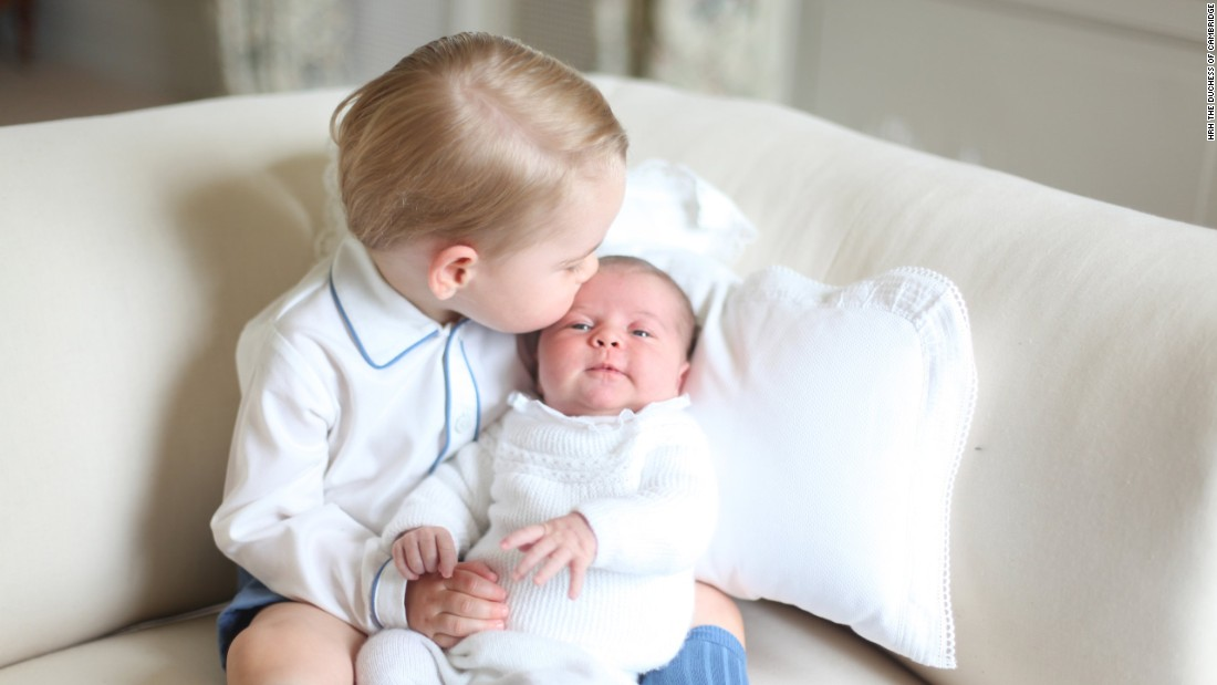 Princess Charlotte is seen with her big brother for the first time in a photo released by Kensington Palace in June.