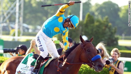 ELMONT, NY - JUNE 06:  Victor Espinoza, celebrates atop American Pharoah #5, after winning the 147th running of the Belmont Stakes at Belmont Park on June 6, 2015 in Elmont, New York. With the wins American Pharoah becomes the first horse to win the Triple Crown in 37 years.  (Photo by Al Bello/Getty Images)