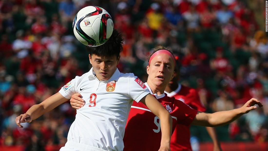 Canada's Josee Belanger, right, defends Wang Shanshan of China.