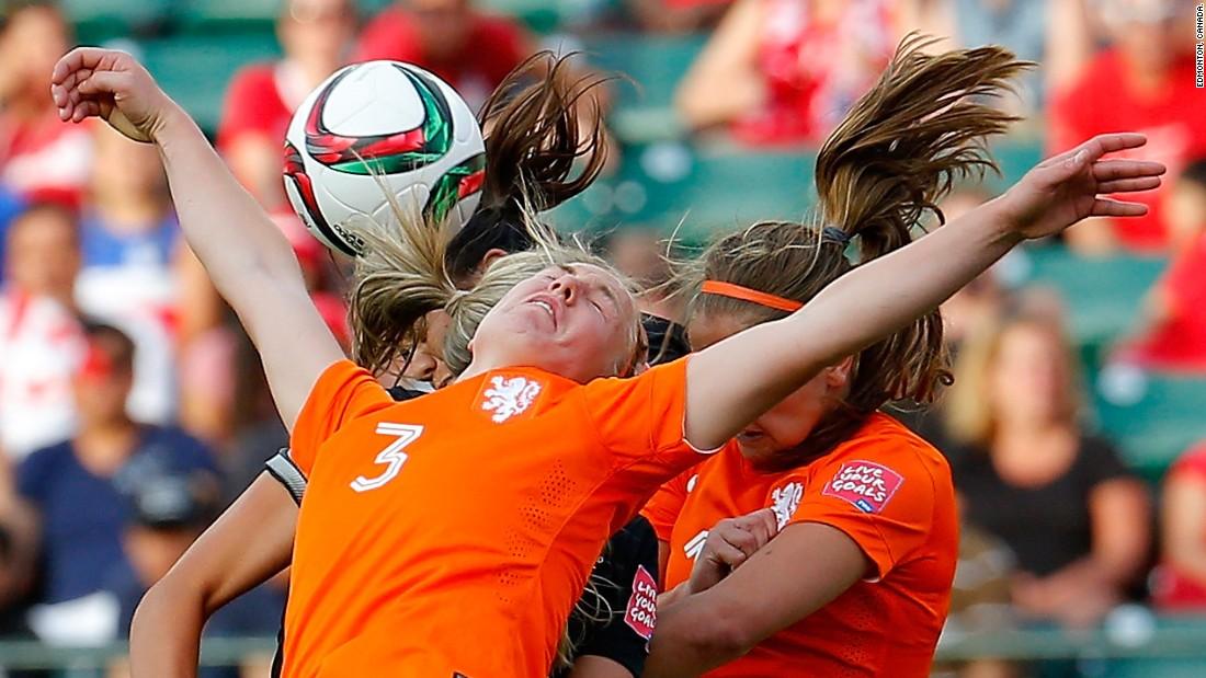 Stefanie Van Der Gragt, front, and Lieke Martens of the Netherlands battle for a header against a New Zealand player.