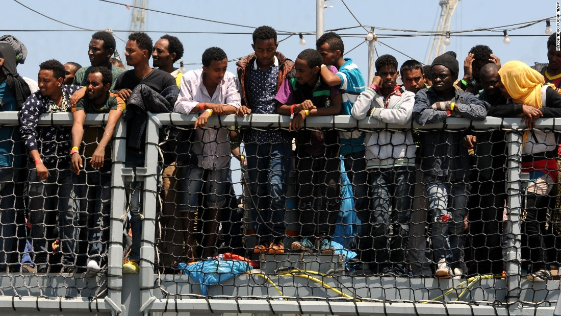 "Migrants wait to disembark from the German navy ship Hessen in Palermo, Italy, on Sunday, June 7. European rescue boats are bringing <a href=""http://www.cnn.com/2015/06/07/europe/mediterranean-migrants-rescue/index.html"">thousands of migrants</a> to safety as they try to cross the Mediterranean Sea. There has been <a href=""http://www.cnn.com/2015/04/21/europe/mediterranean-boat-migrants-lister/index.html"">a surge</a> in the number of migrants making the dangerous journey toward Europe's shores."