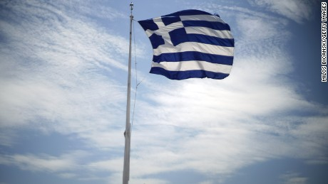 A Greek flag billows in the wind on the Acropolis Hill on June 3, 2015, in Athens, Greece.