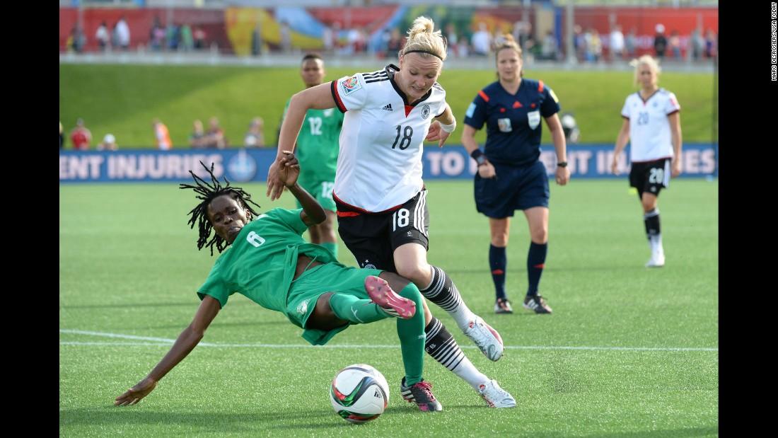 Ivory Coast midfielder Rita Akaffou, left, battles Germany forward Alexandra Popp in the second half of the match.