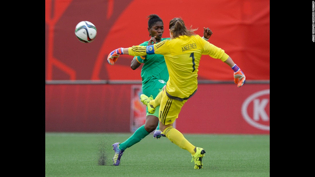 Germany goalkeeper Nadine Angerer kicks the ball away as Ivory Coast's Rebecca Elloh makes a challenge.