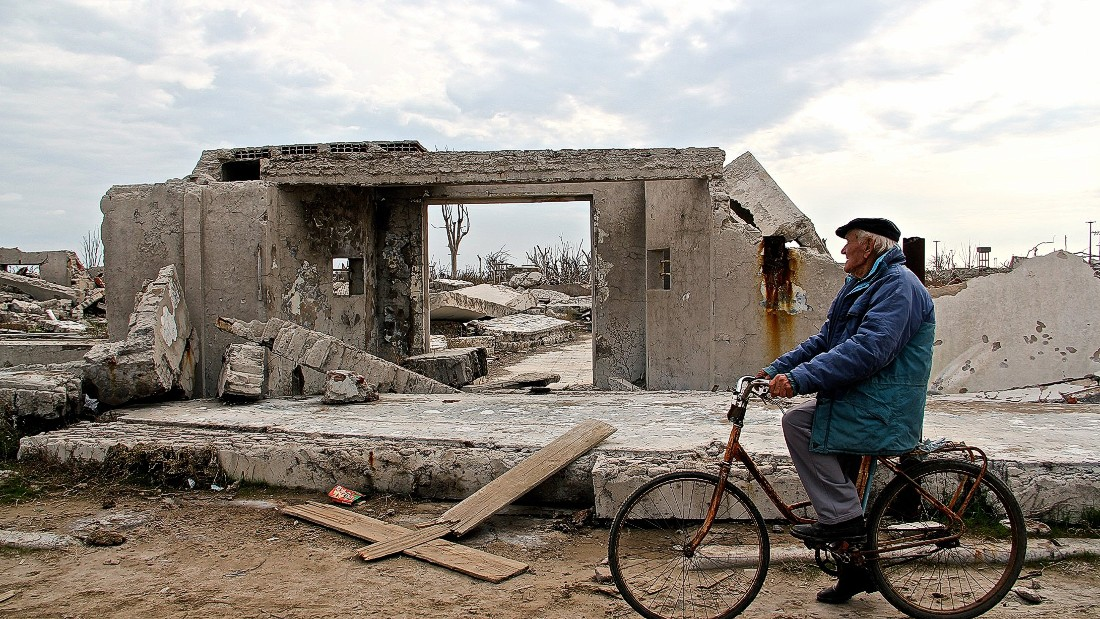 "Novak walks his dog or rides his bike every day. He considers it a ritual. ""At my age, I simply enjoy life, by walking through the ruins of Epecuen,"" says Novak."