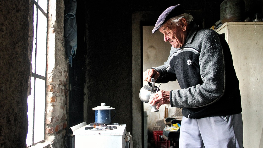Novak prepares maté, a beverage infusion of bitter dried leaves. Though the caffeine-rich drink is traditionally shared with others, Novak says he's used to being alone in this ghost village.