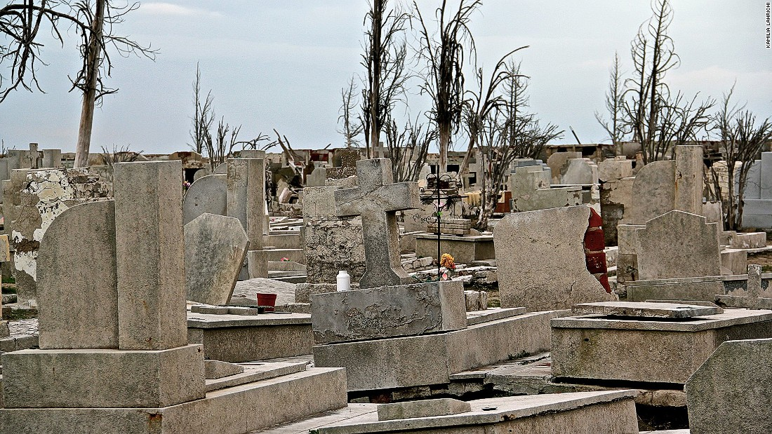 Novak was born in Epecuen and says he'll die there too. Flowers on the cemetery's graves contribute to the sparse colors found in the town.
