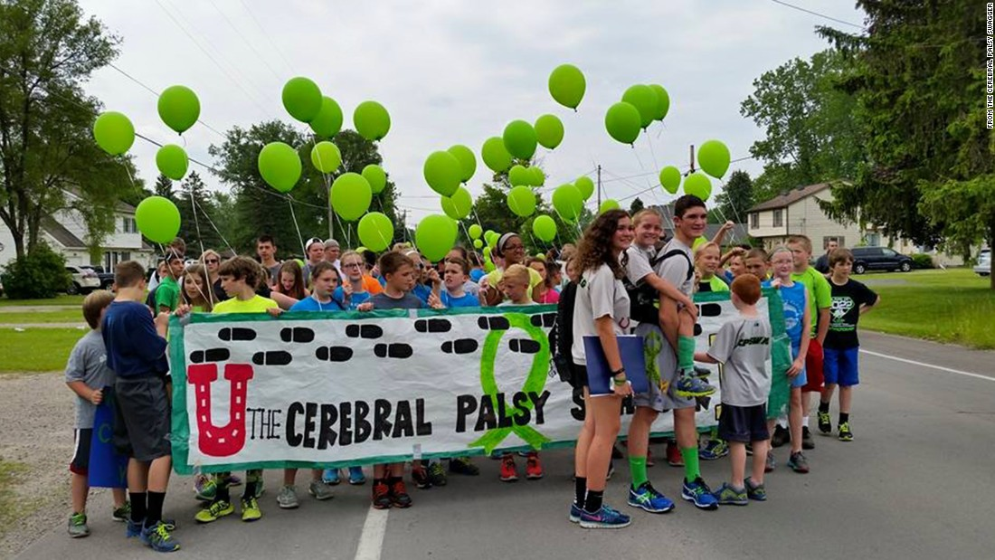 Michigan teen Hunter Gandee carried his little brother Braden 57 miles across Michigan to raise awareness of cerebral palsy, which Braden has. Students from Braden's elementary school in Lambertville, Michigan, joined Hunter to start the walk.