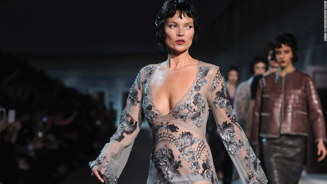 Moss walks the runway during a Louis Vuitton show in 2013. Despite some potentially career-ending controversies -- she was dropped from a number of lucrative contracts following reports of drug abuse -- Moss has never fallen out of favor for long. And even as she approached 40 she was still one of the world's highest-paid models.