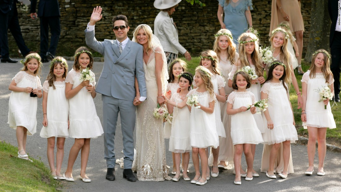 Rock star Jamie Hince and Moss pose for photographs after their wedding in July 2011.