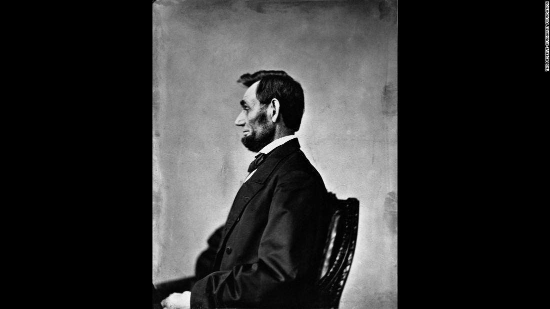 "Lincoln is seen in Washington in this photo taken by Alexander Gardner on November 8, 1863. Lincoln is considered to be the first President photographed while in office. Because the art form was relatively still in its infancy, portrait subjects had to sit still. Of the Lincoln portraits, Holzer wrote: ""No written evidence more powerfully created the 'foundation' of our estimate of Lincoln than the portraits for which he sat before the cameras of his day."""
