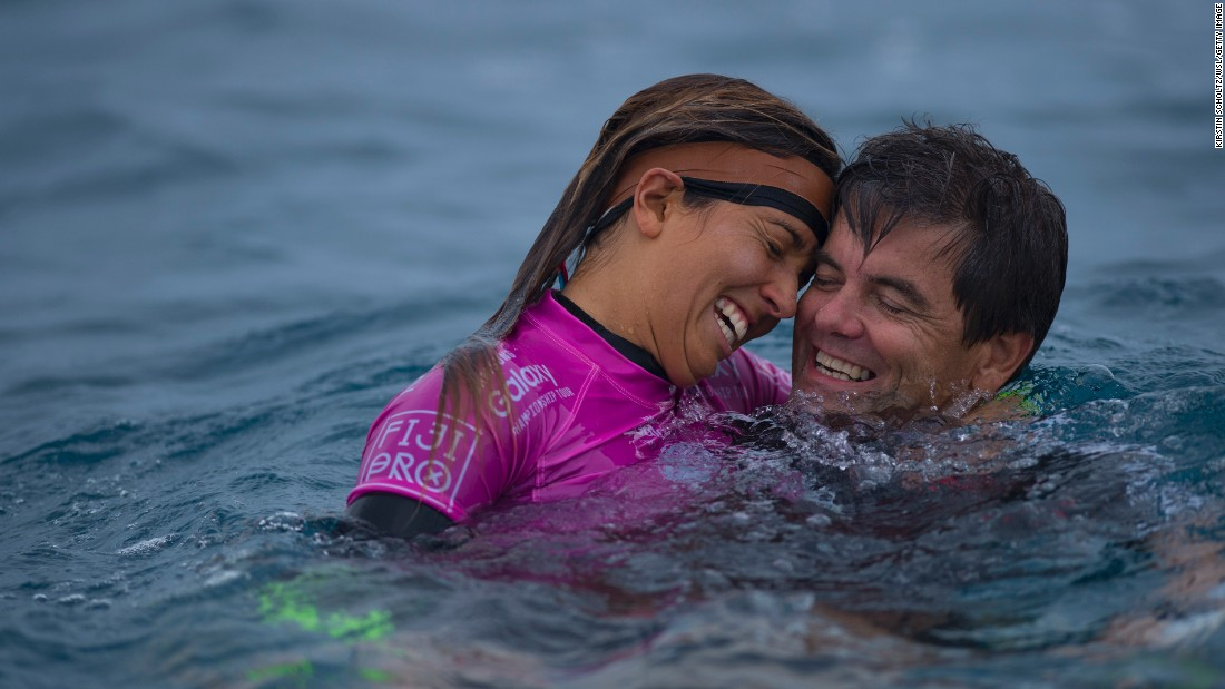 Pro surfer Sally Fitzgibbons celebrates with her father, Martin, after winning an event in Tavarua, Fiji, on Thursday, June 4.