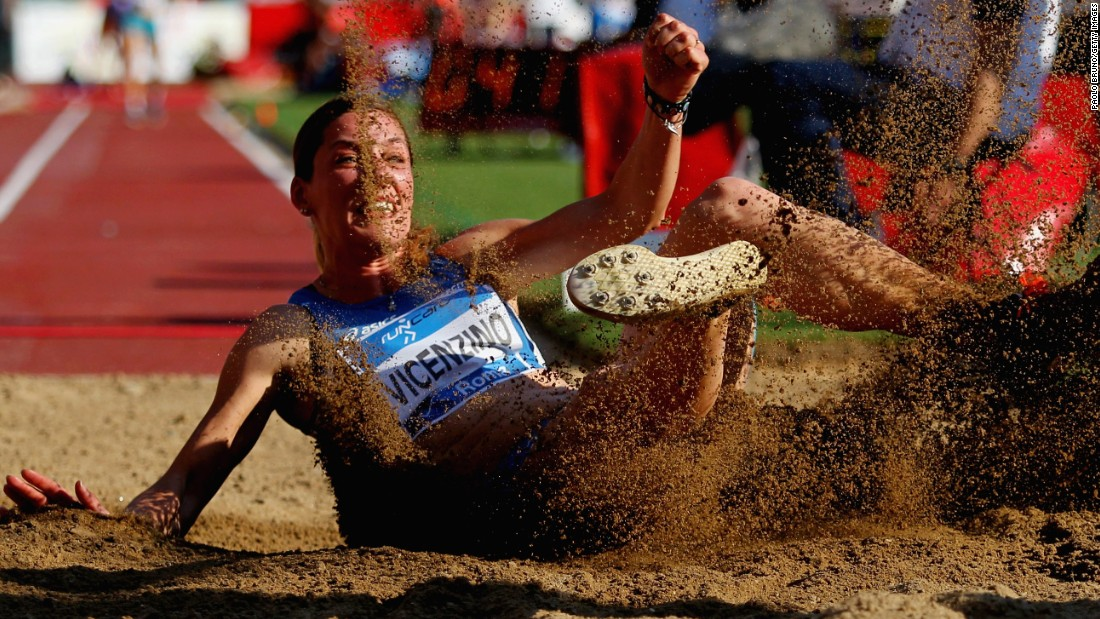 Italian long jumper Tania Vicenzino lands in the sand pit Thursday, June 4, while competing in the Golden Gala track meet in Rome.