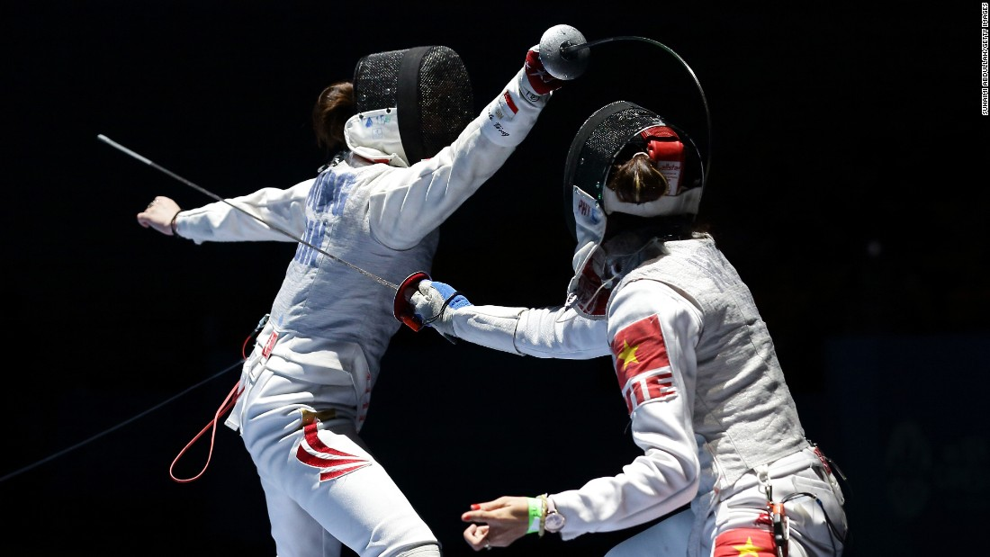 Singaporean fencer Wong Mae Hui Shan Nicole, left, competes against Vietnam's Nguyen Thi Hoai Thu at the Southeast Asian Games on Wednesday, June 3. Nguyen won the quarterfinal match 15-6.