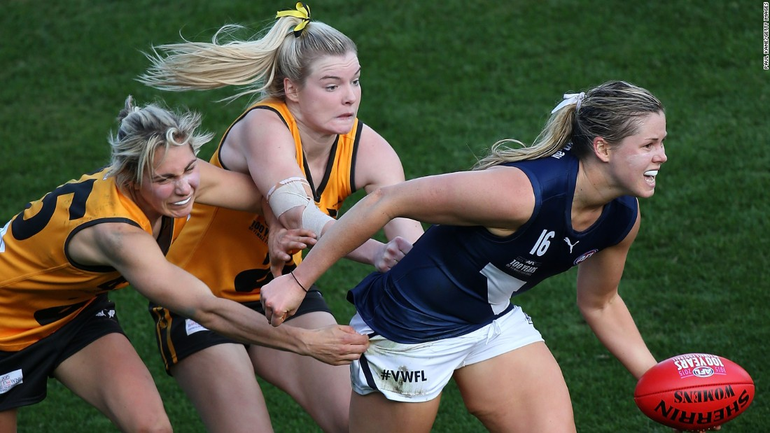 Victoria's Katie Brennan is tackled by two players from Western Australia during an Australian rules football match on Friday, June 5.