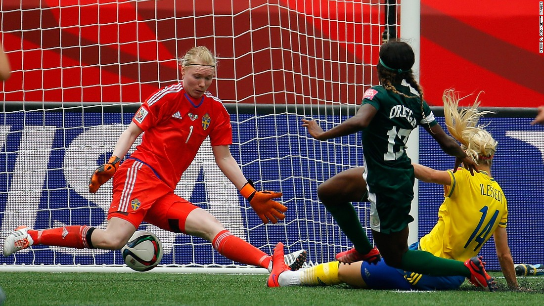 Francisca Ordega of Nigeria scores past Swedish goalkeeper Hedvig Lindahl.