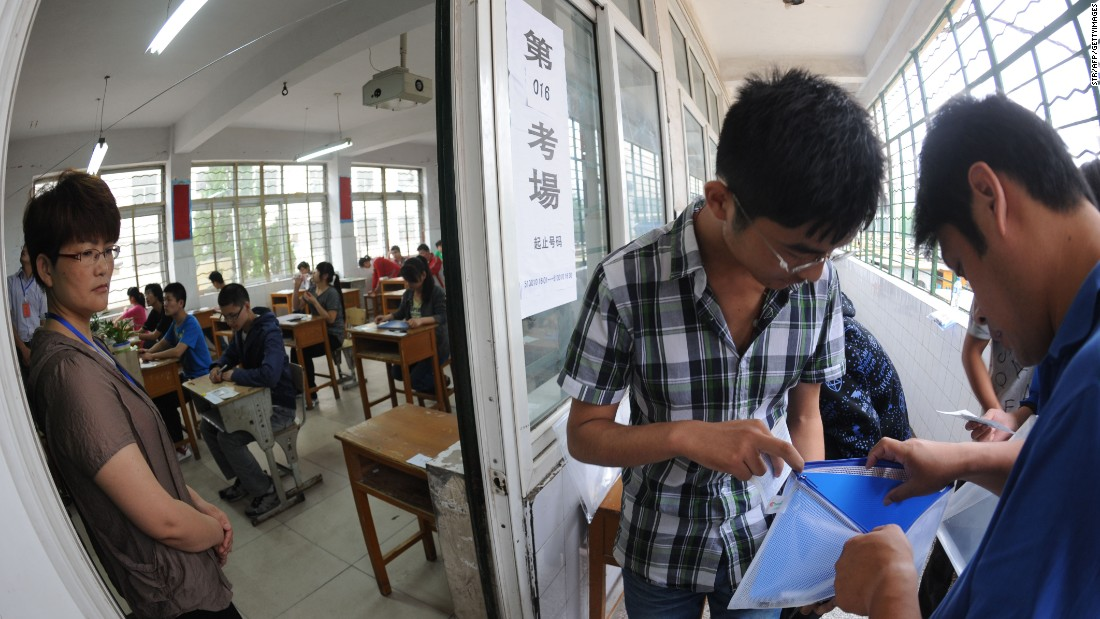 A Chinese student gets his belongings searched before he enters the room to take the tough college entrance exams or Gaokao, in east China's Anhui province on June 7, 2012.