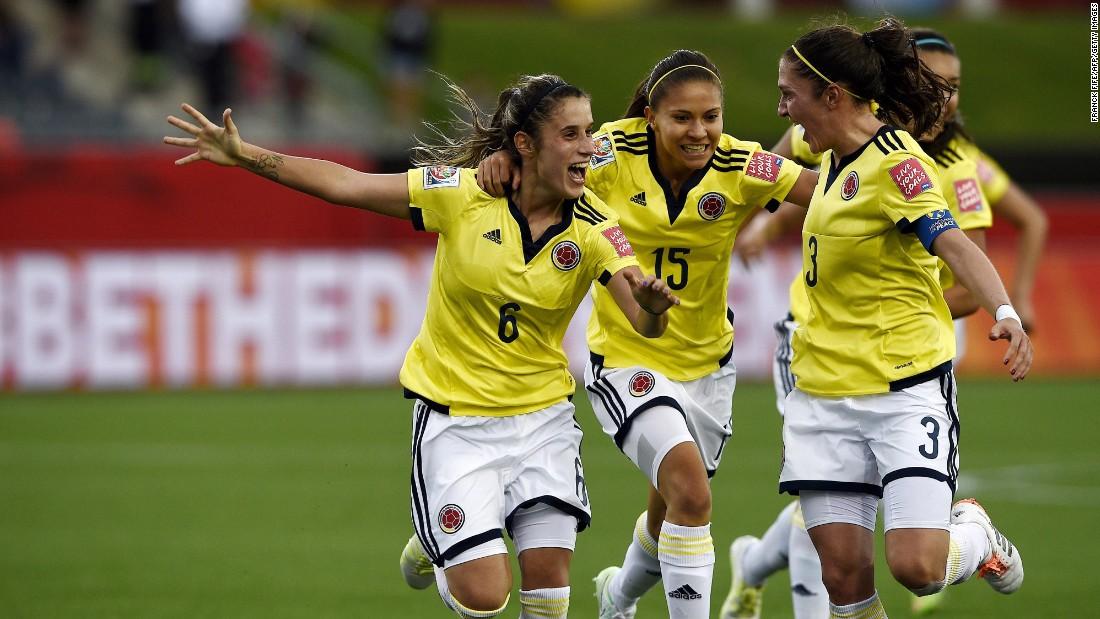 Colombian midfielder Daniela Montoya, left, celebrates her goal with teammates Tatiana Ariza, center, and Natalia Gaitan.