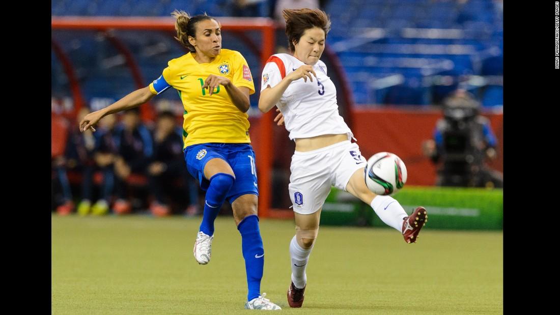 South Korea's Kim Do-yeon tries to move the ball past Marta.