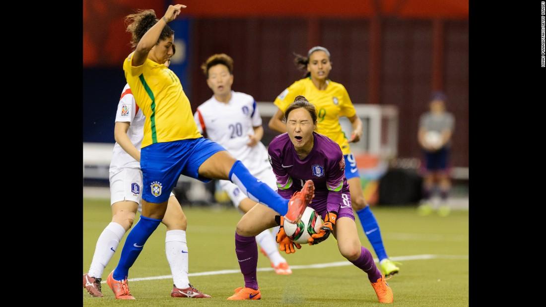 South Korean hoalkeeper Kim Jung-mi makes a save near Brazil's Cristiane.