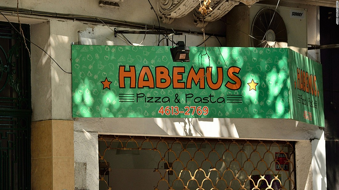 This pizzeria is named after the traditional 'Habemus Papam' announcement following a Pope's election. The Pope's popularity has helped local businesses. A team of Argentinian ice cream makers has even presented the Pope with his own flavor.