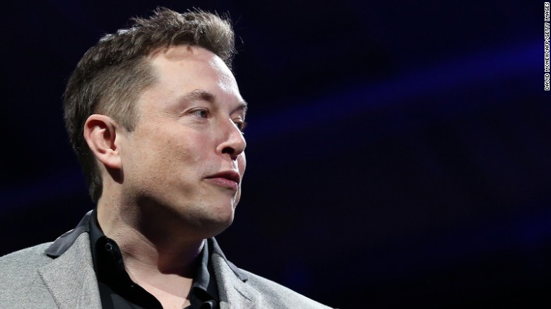 Elon Musk unveils large utility scale home batteries at the Tesla Design Studio in Hawthorne, California, on April 30, 2015.